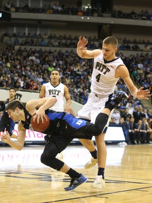Pittsburgh Panthers forward Ryan Luther upends Duke Blue Devils guard Grayson Allen.