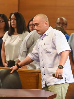 Defendant Mark Torre Jr. prepares to exit the courtroom after his status conference at the Superior Court of Guam on Friday, Sept. 23.