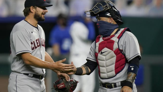 Cleveland Indians relief pitcher Brad Hand, left, celebrates with catcher Sandy Leon following the team's baseball game against the Kansas City Royals at Kauffman Stadium in Kansas City, Mo., Wednesday, Sept. 2, 2020. The Indians won 5-0.