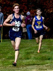 Notre Dame's Garrett Butters wins the boys Class D Section 4 cross country state qualifier at Chenango Valley State Park on Thursday.