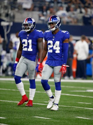 Giants safety Landon Collins (21) and cornerback Eli Apple (24).