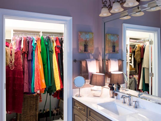 The closet at the end of the master bath is filled with the colorful dresses Deborah favors.
