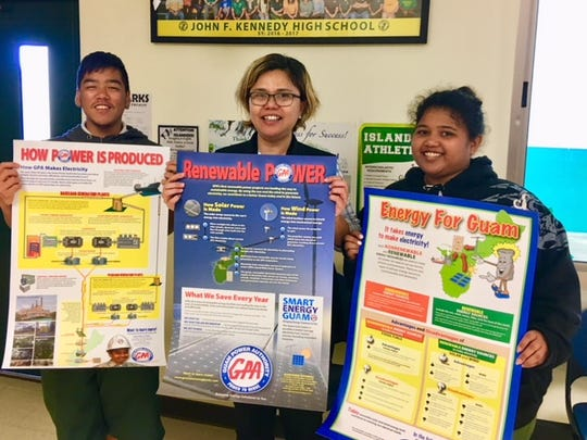 Guam Power Authority donated education and informational materials to the John F. Kennedy (JFK) Senior High School Math and Science Departments on Dec. 18. Pictured from left: Arthur Yalung, Senior; Catherine Dineago, JFK Assistant Principal and Viktoryah Chugrad, Senior.