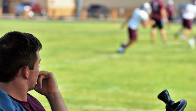 Hawley senior quarterback Quay Stokes watches his teammates practice from a golf cart on Wednesday, Sept. 6. Stokes, an all-Big Country performer, suffered a broken leg in the first quarter of Friday's game against Munday.