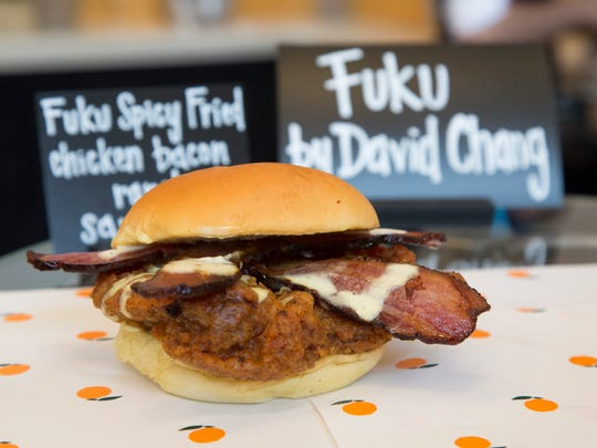 The Fuku Spicy Fried Chicken Bacon Ranch Sandwich is made with habanero-brined, spicy fried chicken thigh on a Martin's potato roll, topped with applewood smoked bacon, Fuku ranch and pickles. It is the newest culinary offering of 2016.