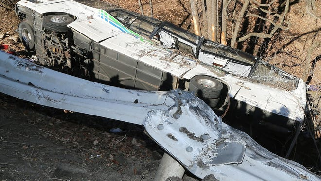 The wreckage of a bus that crashed after running off a road in Karuizawa, Nagano Prefecture, on January 15, 2016.