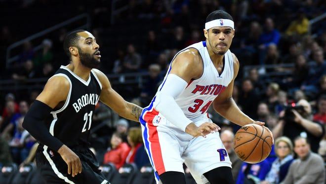 Mar 19, 2016; Auburn Hills, MI, USA; Pistons forward Tobias Harris goes to the basket against Brooklyn Nets guard Wayne Ellington at The Palace of Auburn Hills.