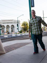 Greg Bertram, left, and Jessica Foth walk with a bottle of wine into The Nash jazz club.