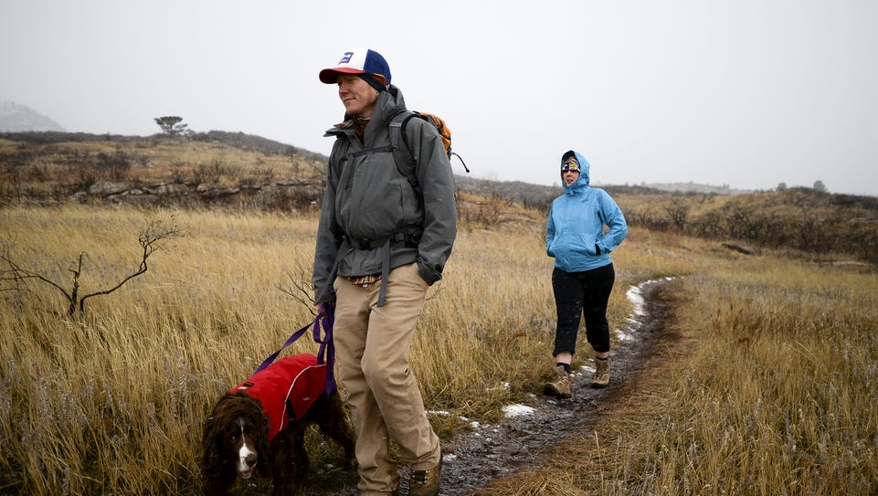 Matt and Torrie Jones hike with their dog Rowley at