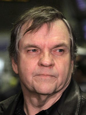 This June 21, 2010, file photo shows rock singer Meatloaf on the floor of the New York Stock Exchange before ringing the opening bell. Meat Loaf collapsed on stage during a concert in Edmonton, Alberta, on Thursday night and was taken to a hospital in unknown condition. The 68-year-old had canceled two other concerts in recent days — in Regina on Saturday and in Calgary on Tuesday — citing ill health.