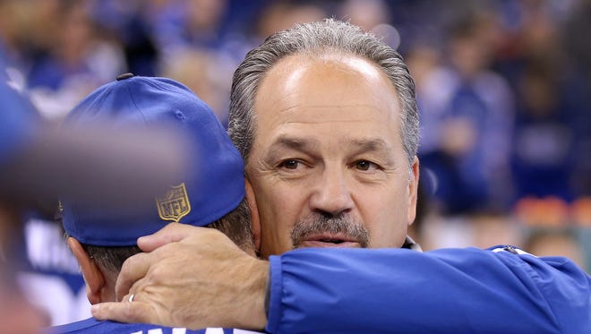 Indianapolis Colts head coach Chuck Pagano hugs kicker Adam Vinatieri (4) at the start of their game. The Indianapolis Colts defeated the Tennessee Titans 30-24 Sunday, January 3, 2016, afternoon at Lucas Oil Stadium.