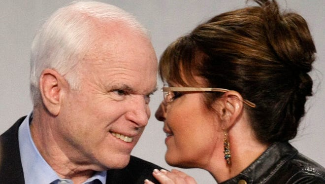 Sen. John McCain and former Republican vice presidential nominee Sarah Palin make a campaign appearance on March 26, 2010, at the Pima County Fairgrounds in Tucson, Arizona.