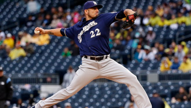 Starting pitcher Matt Garza delivers in the first inning.