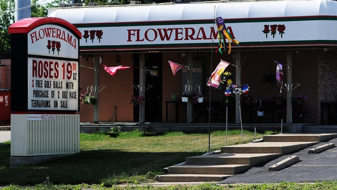 Above: Flowerama stands on the southeast corner of the intersection of 41st Street and Marion Road. Right: Chuck Kuntze in his flower shop on Valentine's Day.