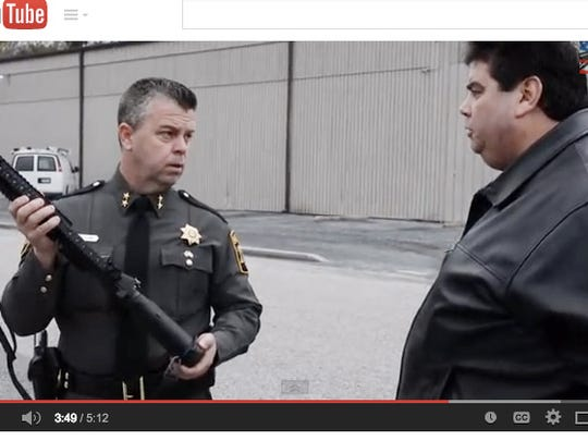 A screenshot of a video on YouTube about gun safety. Wicomico County Sheriff Mike Lewis is at left.