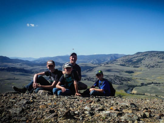 Harley McAllister and his sons Kaden, Tavin and Logan.
