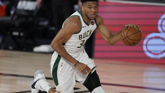 Milwaukee Bucks' Giannis Antetokounmpo (34) in the second half of an NBA conference semifinal playoff basketball game against the Miami Heat Friday, Sept. 4, 2020, in Lake Buena Vista, Fla.
