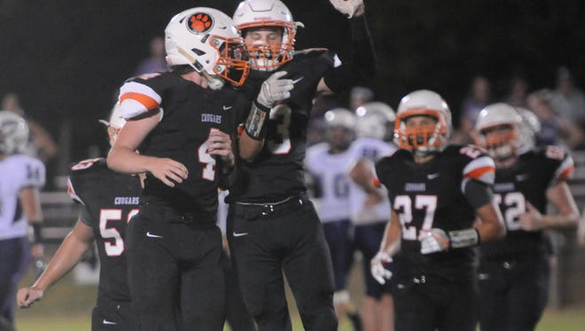 MTCS' Josh Letzler (3) celebrates with Spencer Simmons (4) after Simmons intercepted a pass Friday.