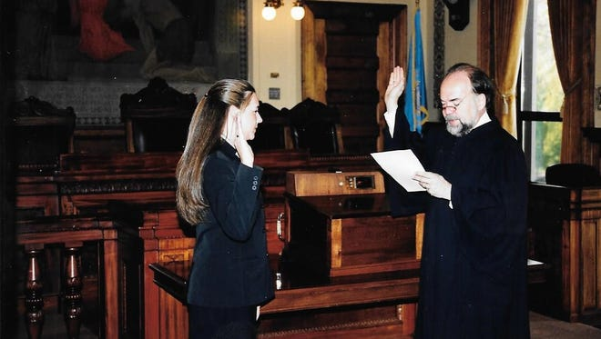 Laura Zylstra Kaiser being sworn in as a Division of Criminal Investigation agent by South Dakota Supreme Court Justice David Gilbertson in 2003.
