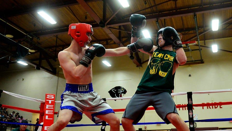 Great Falls High's Brandon Albert throws a jab as CMR's