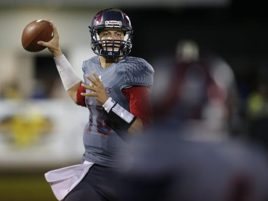 Wakulla quarterback Feleipe Franks throws the ball against Rickards during a playoff game last Friday night. Franks has decommitted from LSU and could soon be heading to Florida.