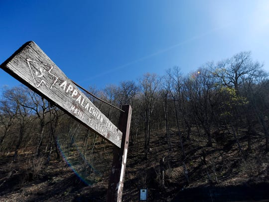 A large wooden sign indicates the trail head on South River Road in Reed Township, less than an hour from York.
