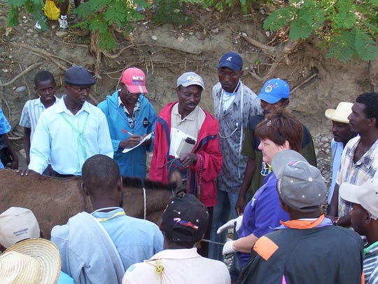 Dr. Lee Ann Fosidck, right in blue shirt, teaches veterinary agents in the  Hinche area of Haiti in 2006.