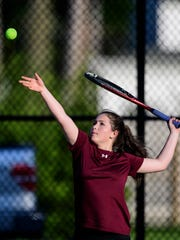 Henderson County's Isabelle Wright (pictured) serves