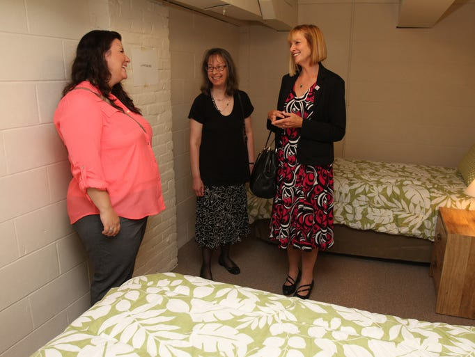 Jamie Busch, Coordinator Human Service Advisory Committee,  Karen Reeman, Program Manager Samaritan House and  Ginger Harris Board President  All Saints Community Center in Lakewood talk during open house tour of Samaritan House,  which will be used as a temporary shelter and offer comprehensive support for 9  homeless people.  Saturday, June 7, 2014, Lakewood. Photo by Robert Ward