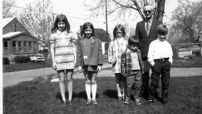 Five of the seven Pietzold children — from left, Martha, Anna, Theresa, Tom and John — stand with their father, Alfred William Pietzold II.