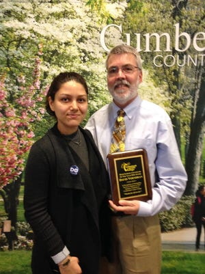 David Vorndran, guidance supervisor at Millville High School, was recognized for his dedication and service to Millville students during Cumberland County College's annual High School Counselors' Breakfast. He is pictured with Gabriela Cuadra, a Millville High graduate who spoke on a student panel about success at CCC.
