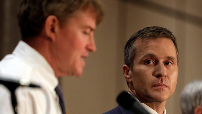 Republican gubernatorial candidate Eric Greitens, right, listens alongside Democratic challenger Chris Koster during the first general election debate in the race for Missouri governor at  the Missouri Press Association convention Friday, Sept. 30, 2016, in Branson, Mo.