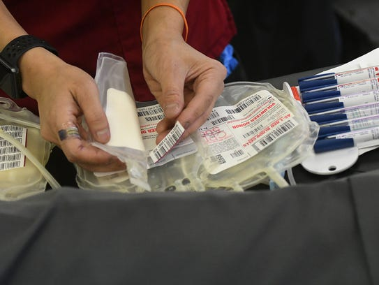 American Red Cross blood donation bags are prepared