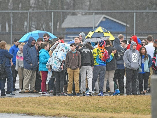 Crestline students and staff huddle in the rain while