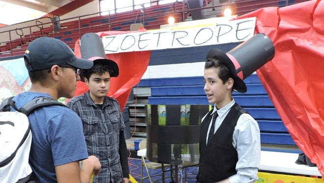 Carlos Hultsch, left, and Cristián Ramirez explain their zoetrope to students at the DHS Science Expo.