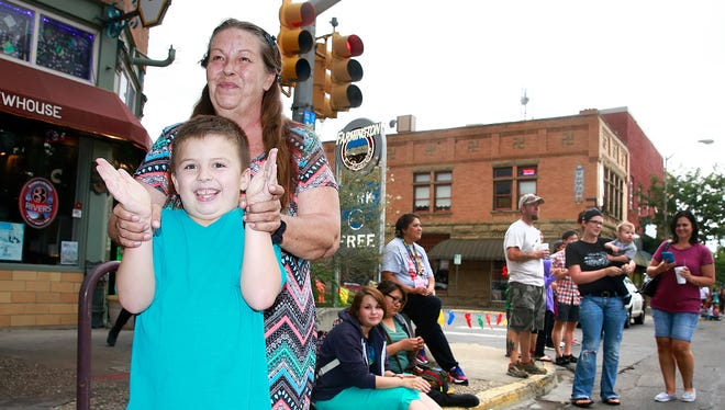 Deborah Hall and her grandson, Charlie Bounds, 7, watch the San Juan County Fair parade on Friday on East Main Street in downtown Farmington.