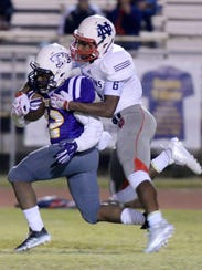 Benton's Jermaine Newton Jr. tries to run past North