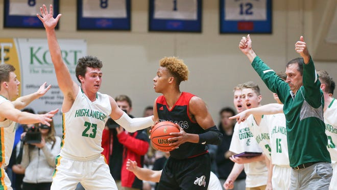 It almost took three people to guard top-ranked prospect Romeo Langford as FC's head coach Todd Sturgeon shouts defense instructions at the Floyd Central-New Albany High School boys basketball game Dec. 8 in Floyds Knobs.