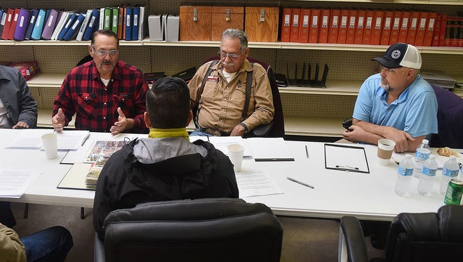 From left, Dale Archuleta, Leonard Trujillo and Andrew Dean, all members of the Bloomfield Irrigation District board, speak with U.S. Rep. Ben Ray Luján, D-New Mexico, on Tuesday at the district office in Bloomfield.