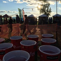 A player throws volleyballs in earnest to try to beat the record at Giant Beer Pong at Oktoberfest Vermont 2016.