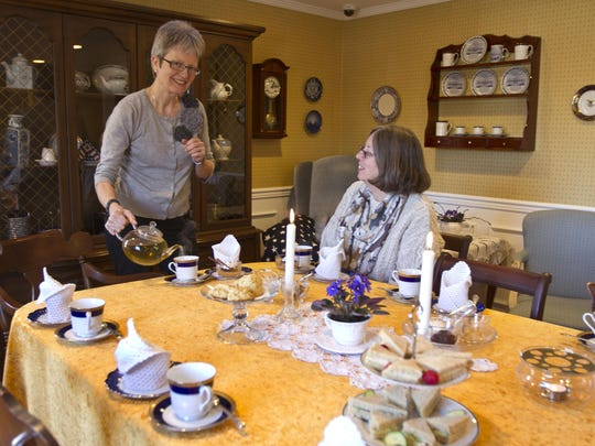 Kirsten Kristensen, tea coach and certified tea specialist, pours a cup for Betty Lou Cox of Toms River at The White House in Oakhurst in 2014.