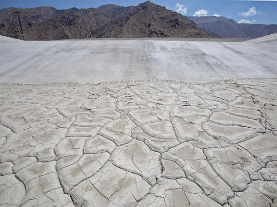 The cracked dry surface of Percolation Pond 5 awaits water at Windy Point. The percolation ponds are used to refill the aquifer beneath the Coachella Valley with Colorado River water.