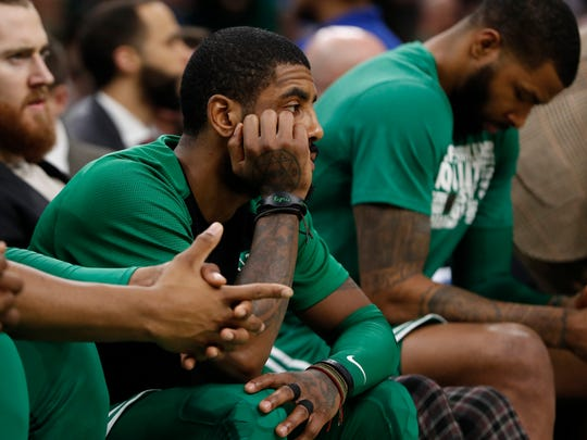 Boston Celtics guard Kyrie Irving (11) looks on from the bench in the second quarter against the Los Angeles Lakers at TD Garden. Irving struggled in the playoff series with Milwaukee as the Celtics were beaten 4-1, losing four straight to the Bucks.