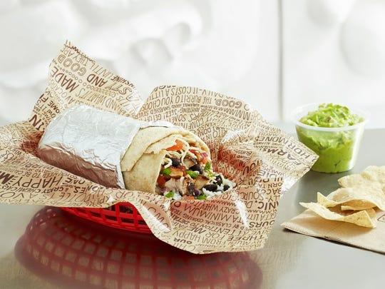 A Chipotle burrito with a side of guacamole.