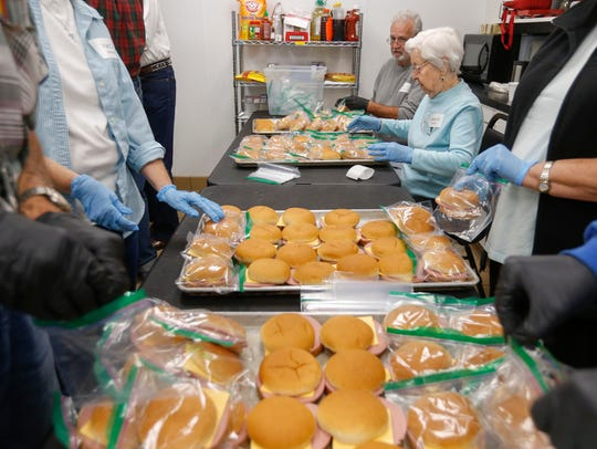 Dorothy Erland, of Branson, helps make sandwiches while