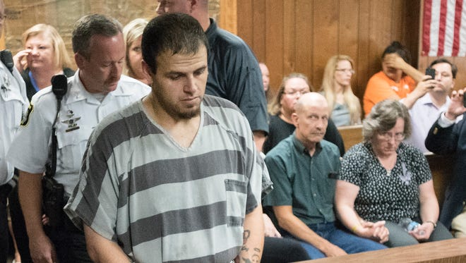 Daniel Allen Clay walks past Matt and Leannda Bruck, parents of Chelsea Bruck. He is accused of murdering Chelsea in 2014, and was arraigned at the Monroe County 1st District Court in Monroe, Michigan on July 25, 2016.