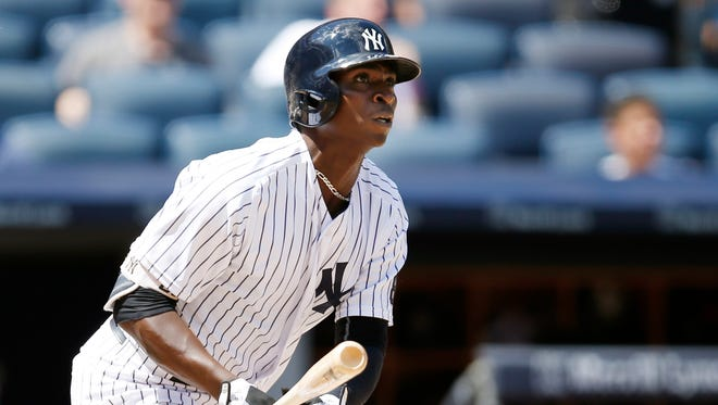 Didi Gregorius watches his fourth-inning solo home run against the Cleveland Indians.