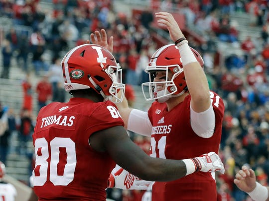 Indiana's Ian Thomas (80) celebrates with quarterback Richard Lagow (21) after Thomas scored on a 57-yard touchdown reception during the first half of an NCAA college football game against Rutgers, Saturday, Nov. 18, 2017, in Bloomington, Ind. (AP Photo/Darron Cummings)