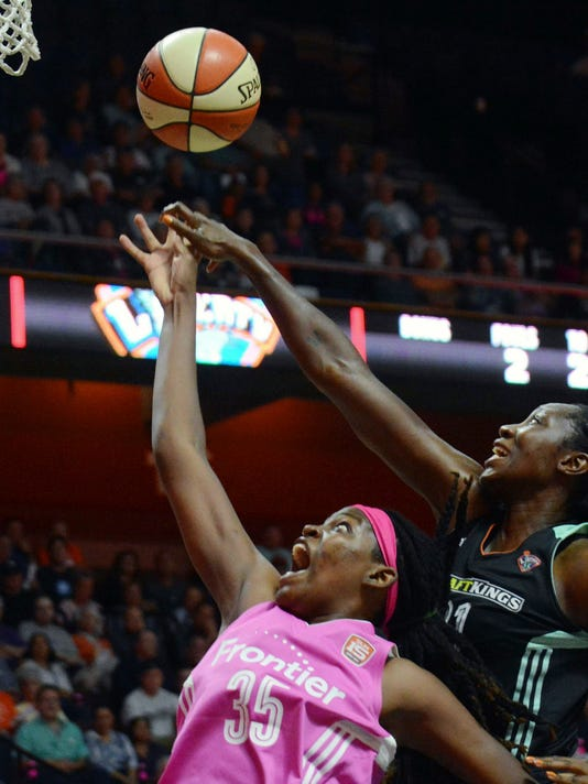Connecticut Sun's Jonquel Jones shoots in front of New York Liberty's Tina Charles, during a WNBA basketball game in Uncasville, Conn., Friday, Aug. 18, 2017. (John Shishmanian/The Norwich Bulletin via AP)