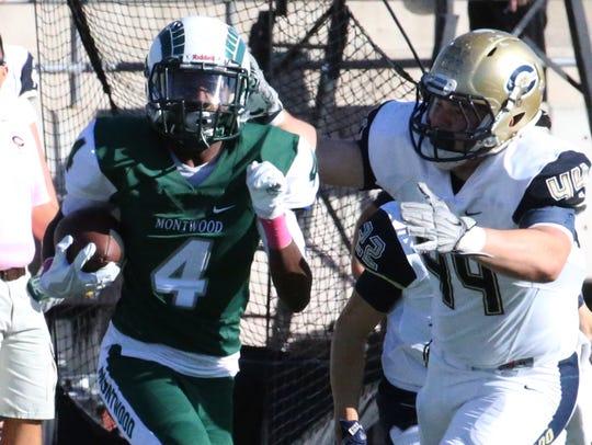 Montwood wide receiver Tyreese Andrus, 4, runs for